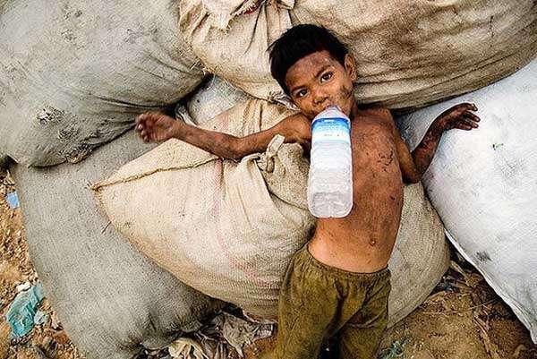 Cuty, Garbage and dump in Cambodia by Swiatoslaw Wojtkowiak
